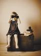 little girl with binoculars indoor