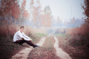 young men in autumn park