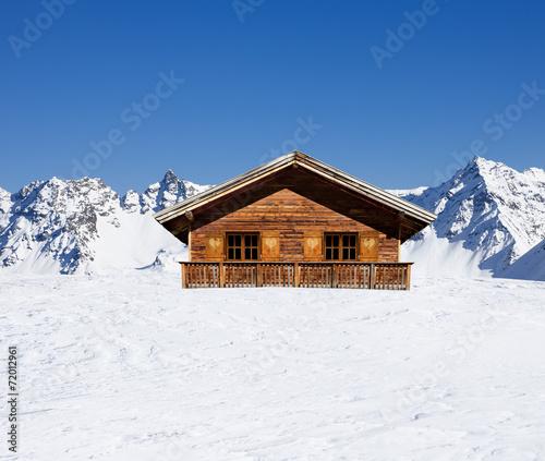 Leinwanddruck Bild Schihütte in den Bergen