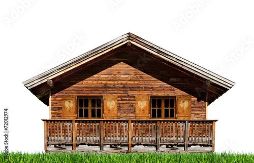 Tuinposter Alpen Almhütte mit Wiese