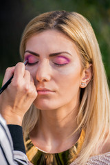 Attractive young woman during a make-up session