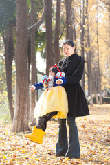 mother and daughter happy togetherness outdoor in forest