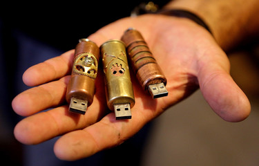 Unique steampunk USB jewelries in man's hands