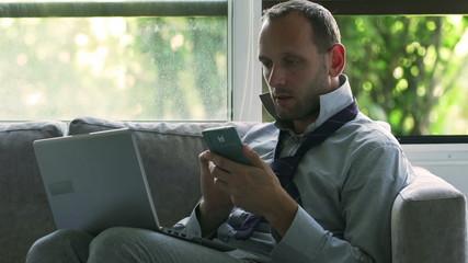 Businessman working at home on modern technology, steadycam shot