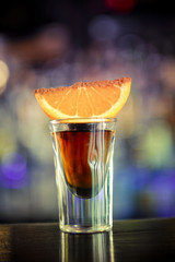 Tequila shot with orange