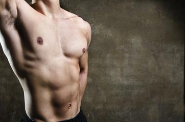 Closeup image of young man torso