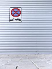 Warning parking sign on the garage door