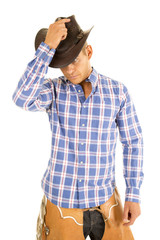 cowboy blue plaid shirt hold hat on head