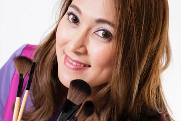 Make-up Artist,Thai beautiful make up artist holding brushes