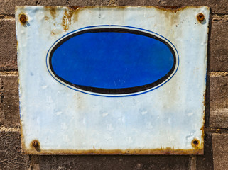 Textured  blue rusty metal background, with crude painted oval s