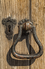 Victorian Iron door knocker and keyhole on wood background