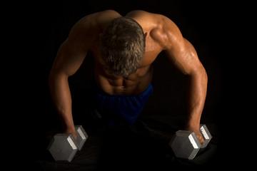 man fitness no shirt on black pushup show back