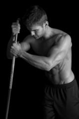 man fitness no shirt on black side light look down flex white