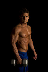 man fitness no shirt on black weight look serious side lift
