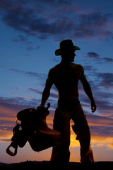 silhouette cowboy no shirt hold saddle look side