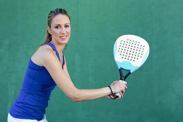 woman holding racket paddleball and waiting ball. sportswoman.