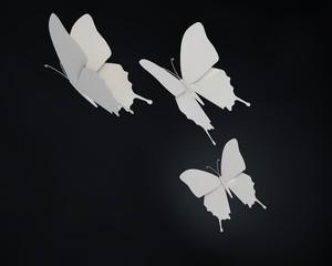 Drie papieren vlinders in de nacht