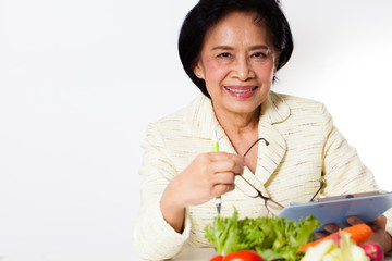 Nutritionist, Female Nutritionist act with a bowl of vegetable
