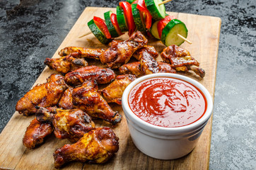 Sticky chicken with red hot dip