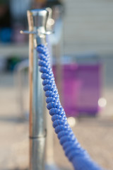 chrome pole and blue rope