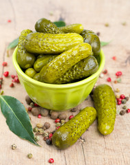 pickled cucumbers in a green bowl