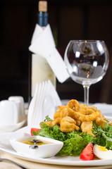 Calamari salad served with wine