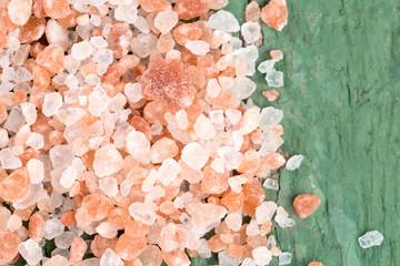 pink salt on old wooden surface