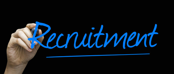 Recruitment hand writing with a blue mark on a transparent board