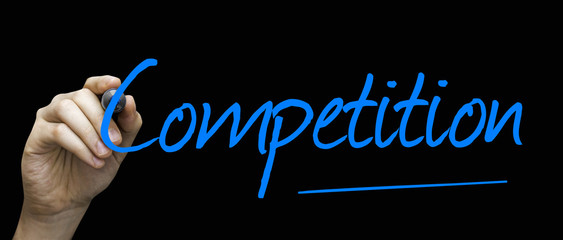 Competition hand writing with a blue mark on a transparent board