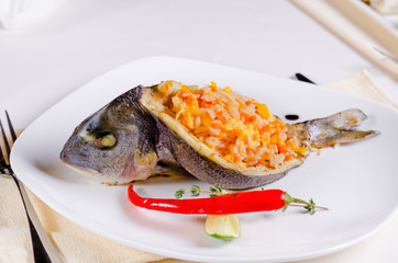 Whole grilled fish stuffed with savory rice