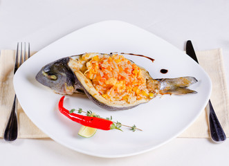 Sliced Grilled Fish Stuffed with Tasty Risotto