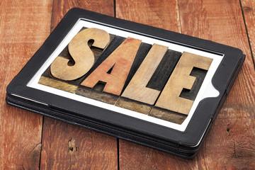 sale word on digital tablet