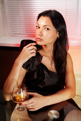 girl with glass of brandy