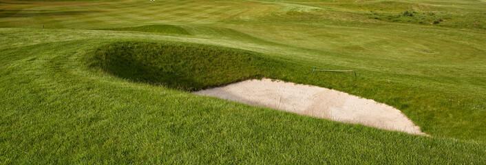Deep golf bunker on a summer golf course