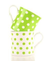 Polka dot mugs isolated on white