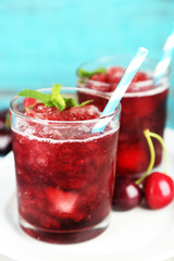 Closeup of cherry granita in glasses, on color wooden
