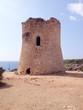 canvas print picture - watchtower on the coast of cala pi