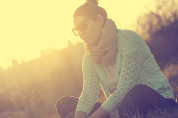 Woman relaxing in sunset