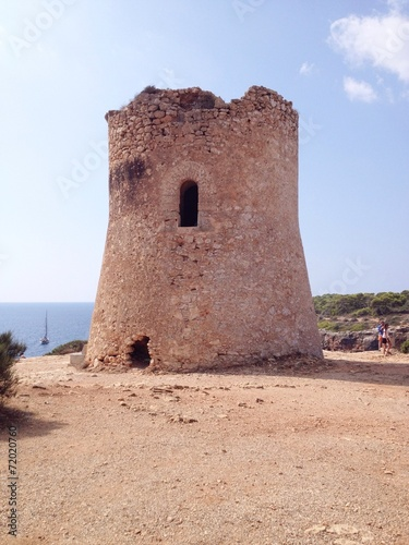 canvas print picture watchtower on the coast of cala pi
