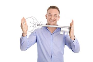 Business Mann hält den Schlüssel zum Erfolg in der Hand