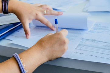 Woman signs a purchase document