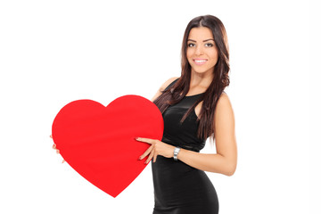 Attractive young woman holding a heart
