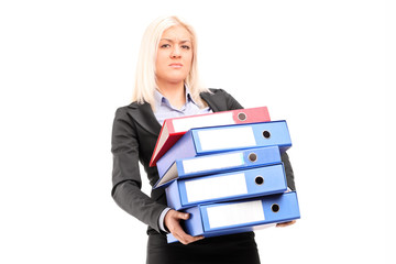 Businesswoman carrying a pile of folders