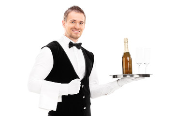 Professional waiter holding a tray with a champagne and glasses