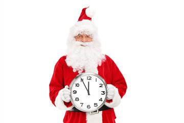 Santa Claus holding a big wall clock
