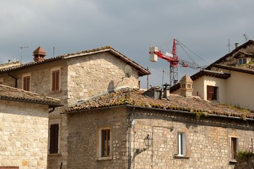 Red crane above antique town