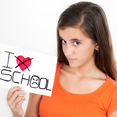 Girl holding a sign with the words I hate school