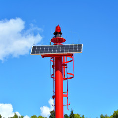 small red solar lighthouse