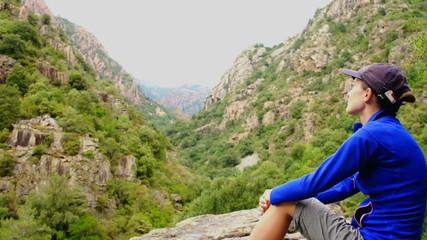 Female tourist enjoying beautiful view in the mountains