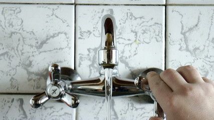 The video shows Water drop from faucet